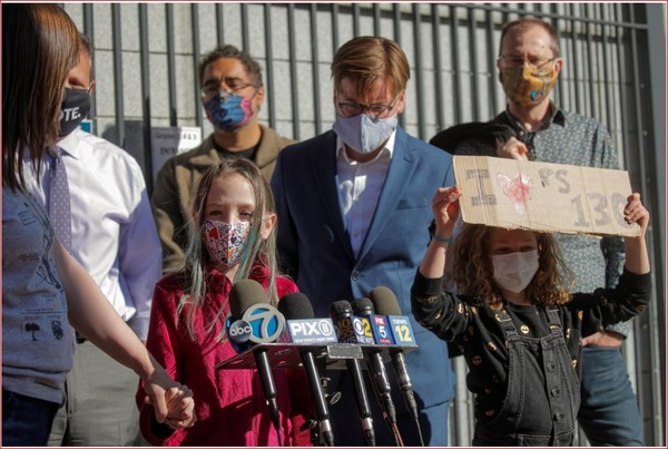 A child speaks to the press during a protest to the closing of Public School 130 outside the school building for safety reasons, following the outbreak of the coronavirus disease (COVID-19) in the Brooklyn borough of New York City, U.S., October 8, 2020. REUTERS/Brendan McDermid